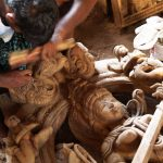 Carving a Wood Saraswati statue