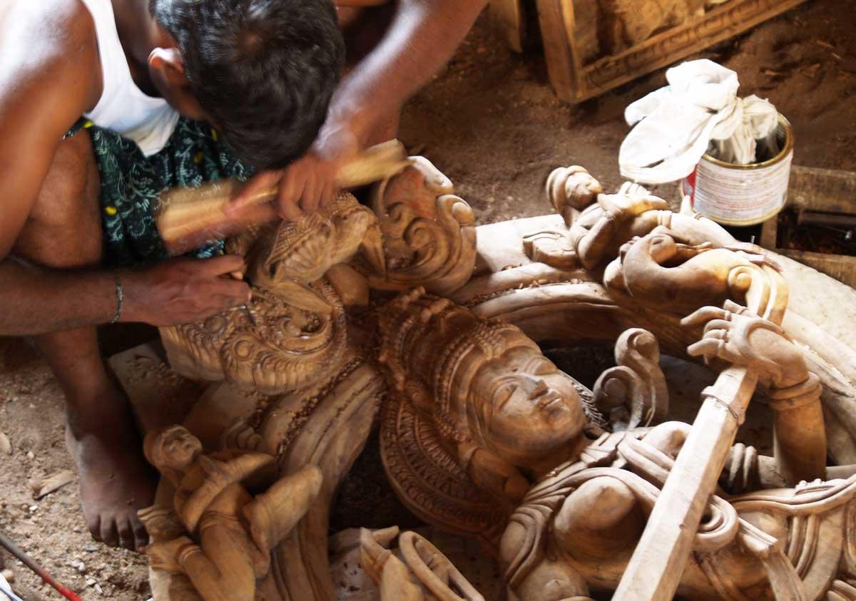 Carving a Wood Saraswati statue