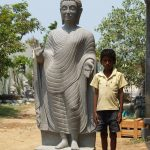 Stone Buddha With Boy