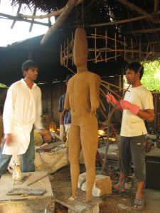 Varun and Varadaraj working on a wax model of Ravendra