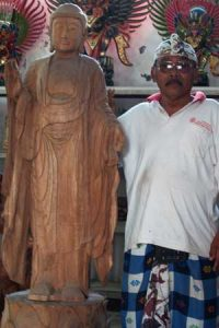 Wayan with unfinished 6 foot Buddha statue