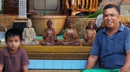wooden buddha statues in Bali