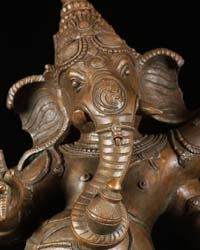 Ganesh murti trunk hanging in the center and curled to the left