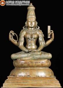 Sarswati holding the vedas