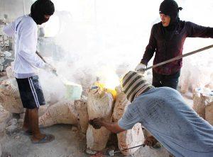 Brass Buddha artists pouring molds -