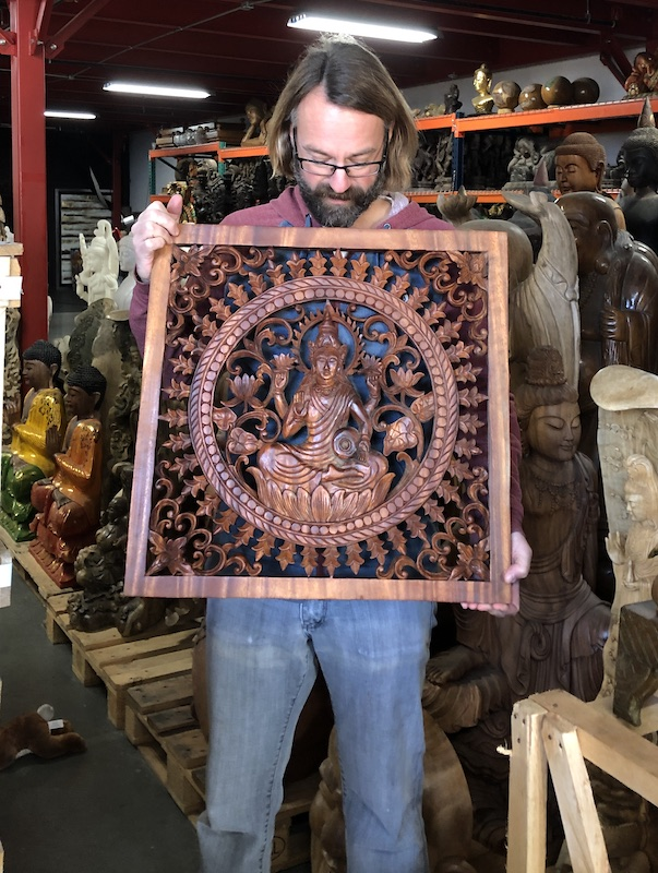 Kyle, founder of Lotus Sculpture, holding the first panel I unwrapped in this shipment of Mr Komang's work