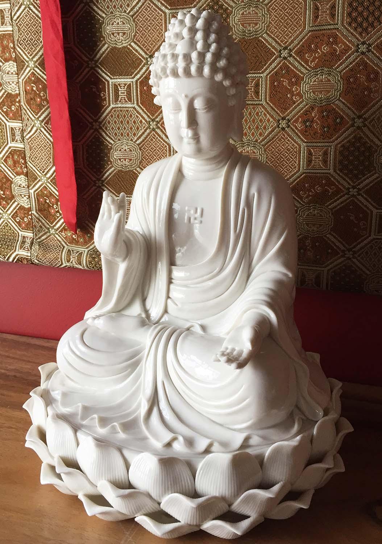 Porcelain Buddha Seated on 3 Tiered Lotus Base
